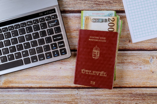 The hungarian passports and different hungarian forints banknotes with computer keyboard Premium Photo