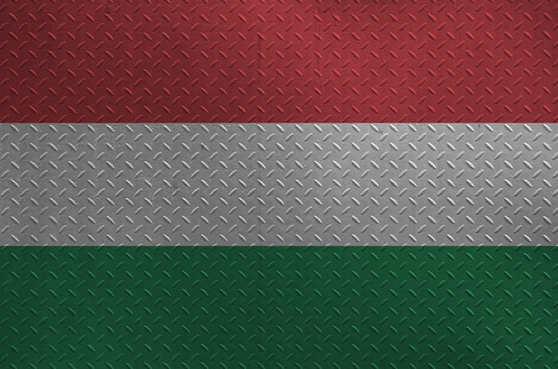 Hungary flag depicted in paint colors on old brushed metal plate or wall closeup. textured banner on rough background Premium Photo