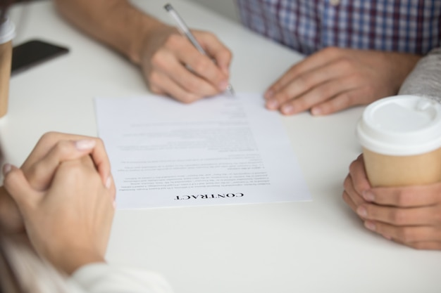 Husband signing contract of buying house Free Photo