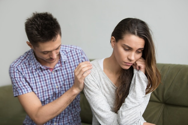 Husband supporting comforting upset depressed wife, infertility and sympathy concept Free Photo