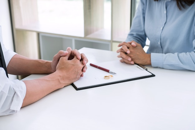 Husband and wife are reading divorce agreement and signing decree of divorce Premium Photo