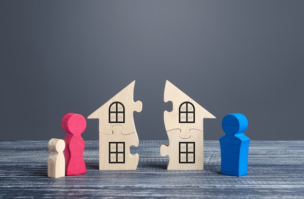 Husband and wife divide a house in a divorce process Premium Photo
