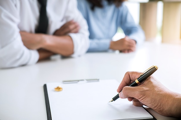 Husband and wife during divorce process with lawyer or counselor and signing of divorce co Premium Photo