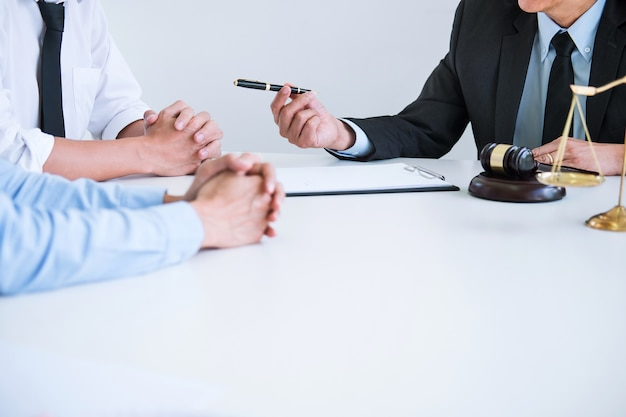 Husband and wife during divorce process with senior male lawyer or counselor Premium Photo