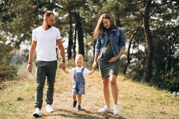 Husband with pregnant wife and their son Free Photo