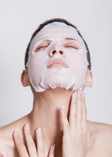 Hydrating face mask on beautiful woman Free Photo