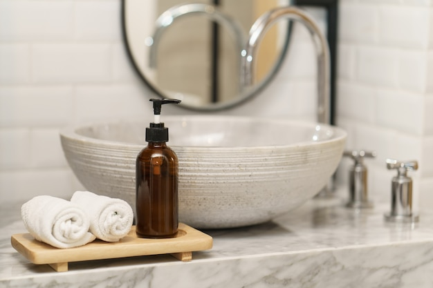 Hygiene concept. towel and soap at sink in bathroom. Premium Photo