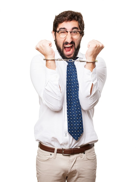 Hysterical businessman with handcuffs Free Photo