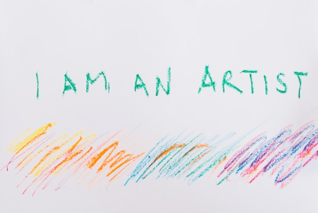 I am an artist' text and colorful crayon stroke on white paper Free Photo
