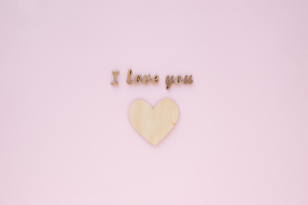 I love you inscription over wooden heart Free Photo