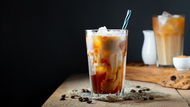 Ice coffee in a tall glass with cream. Premium Photo