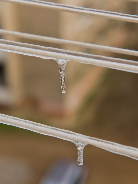 Ice-covered clothesline with icicles. Premium Photo