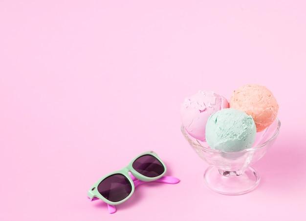 Ice cream balls on glass bowl near sunglasses Free Photo