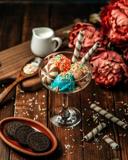 Ice cream balls topped with cookies and candies Free Photo