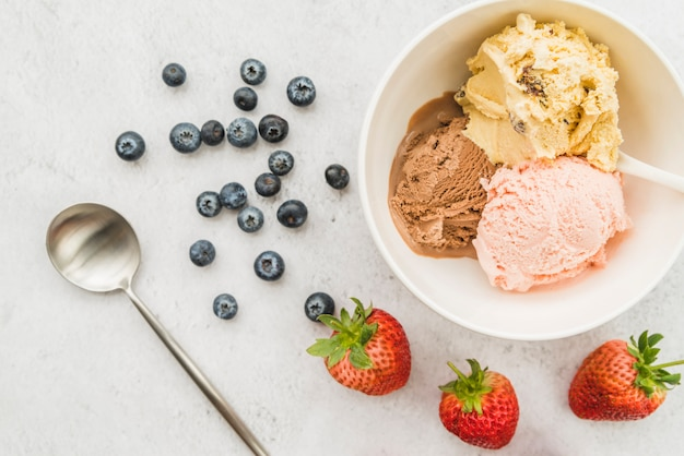 Ice cream in bowl and diverse berries Free Photo