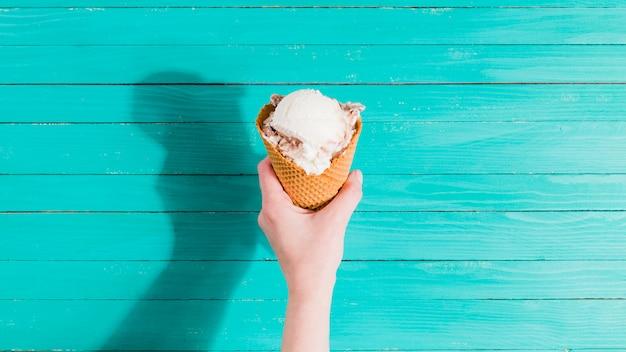 Ice cream cone in hand Free Photo