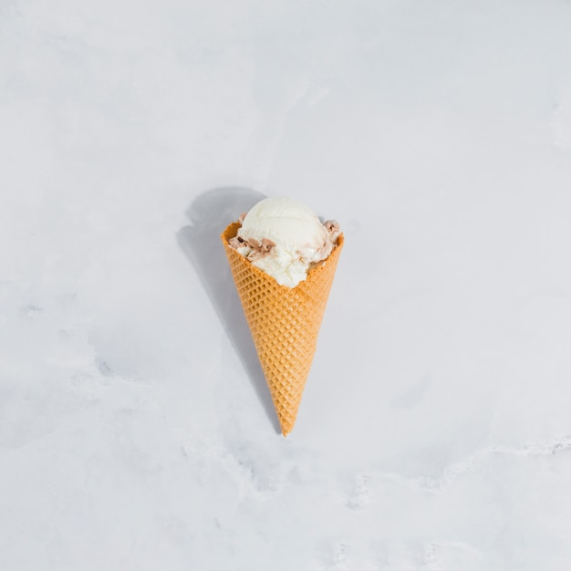 Ice cream cone on marble Free Photo