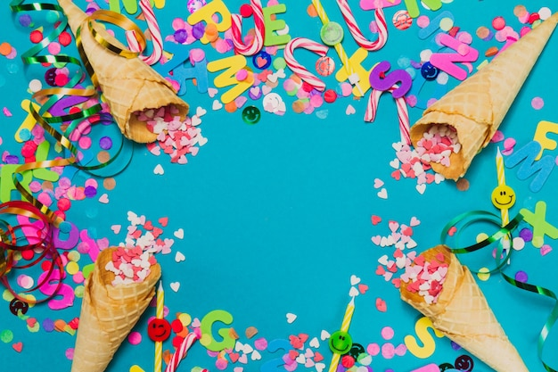 Ice cream cones with hearts and confetti on a blue background Photo | Free Download
