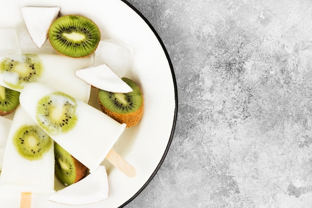 Ice cream from yogurt / coconut milk from kiwi on a light background Premium Photo