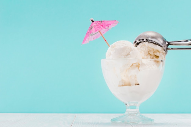 Ice cream in glass vase and metal spoon on top Free Photo