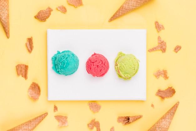 Ice cream scoops and broken cones Free Photo