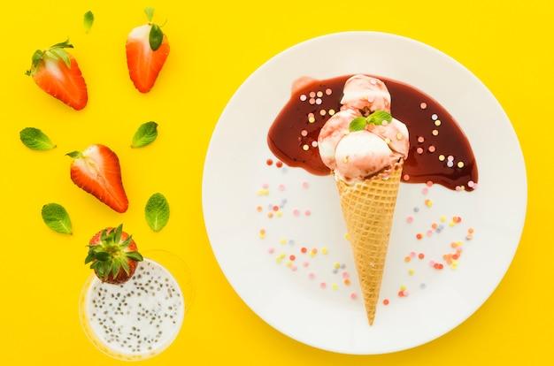 Ice cream in waffle cone with milk shake Free Photo