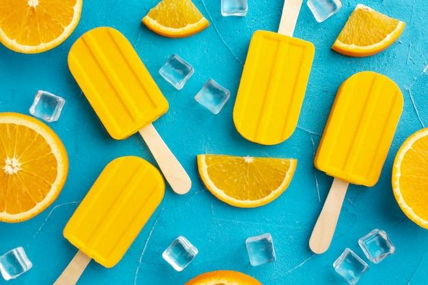 Ice cream with orange flavour and ice cubes Free Photo