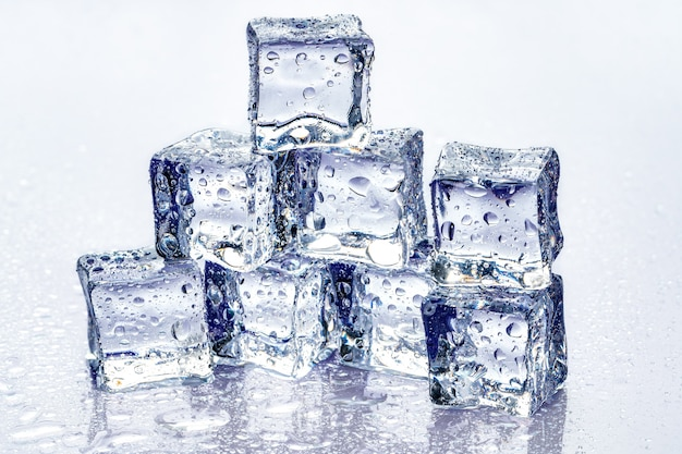 Ice cubes on blue Premium Photo