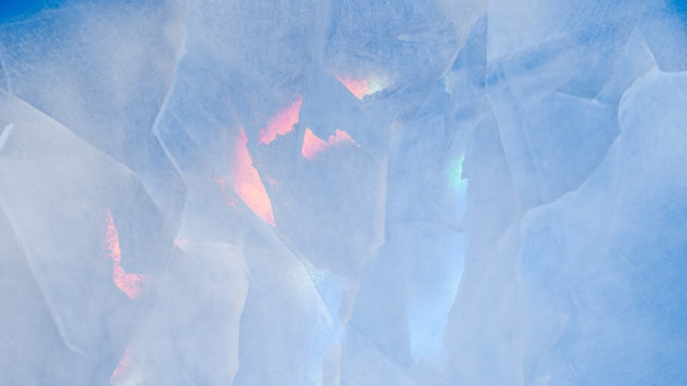Ice texture with colorful iridescent multi-colored reflections Premium Photo