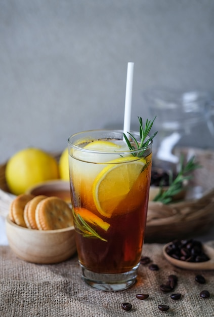 Iced coffee with lemon and rosemary Premium Photo
