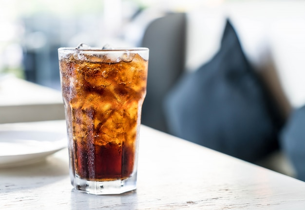 Iced cola on the table Free Photo