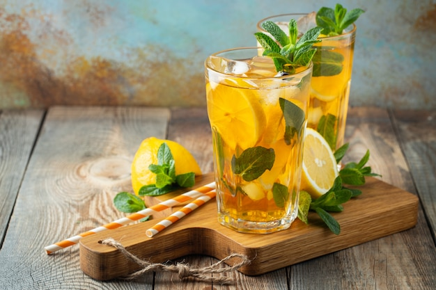 Iced tea with lemon and ice in tall glasses. Premium Photo