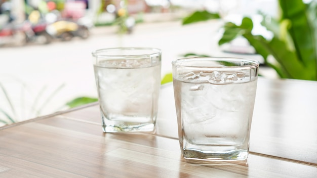 Iced water on a wooden table. Premium Photo