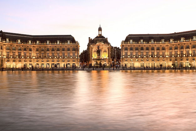 Iconic of place de la bourse and water mirror fountain in bordeaux france, gironde Premium Photo