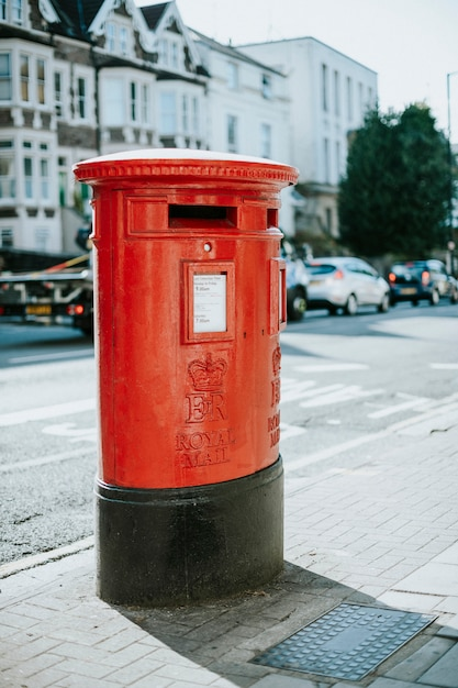 Iconic red british mailbox in a city Free Photo