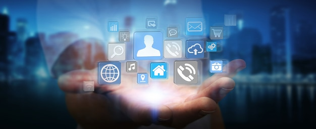 Icons connected to each other over businessman hand Premium Photo
