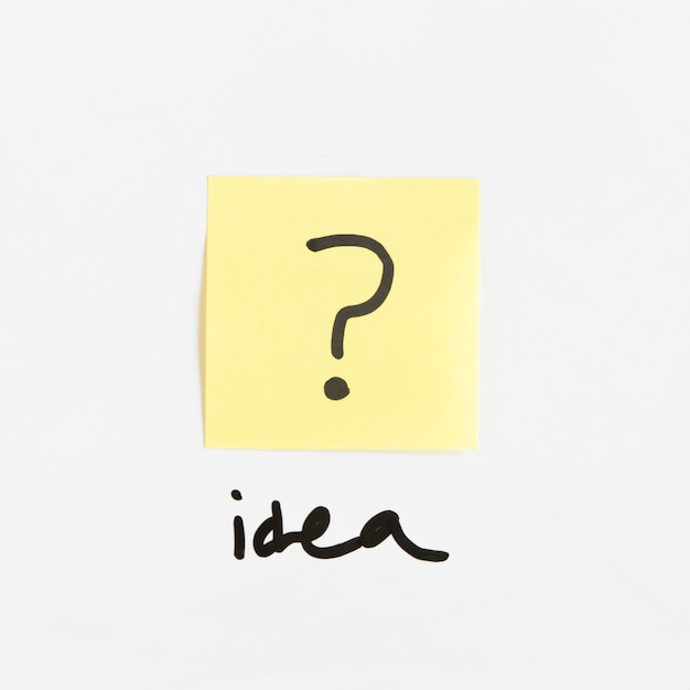 Idea word near adhesive note with question mark sign Free Photo