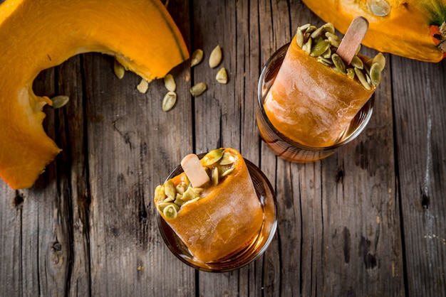 Ideas for autumn dishes from pumpkins. treats for a thanksgiving party, halloween.  top view Premium Photo