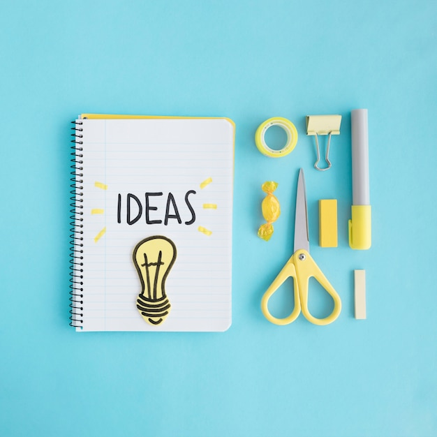 Ideas light bulb with stationary on blue background Free Photo