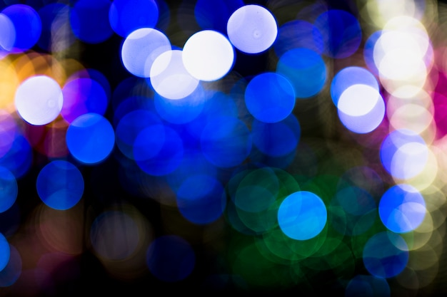 An illuminated blue bokeh abstract background Free Photo