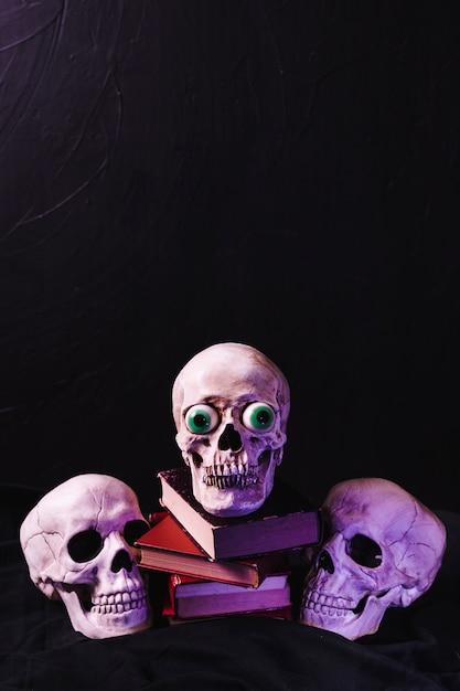 Illuminatedby purple light skulls Free Photo