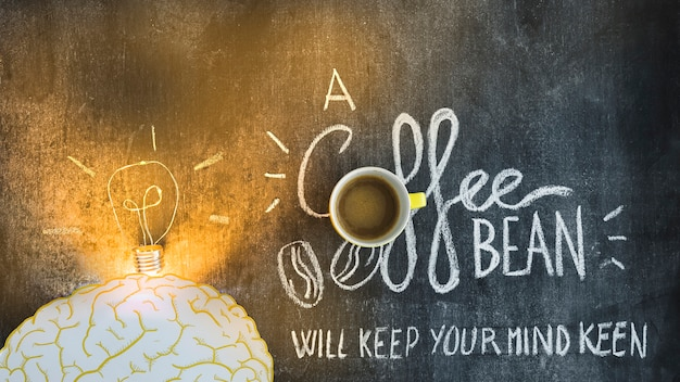 Illuminated light bulb over the brain with text on blackboard Free Photo