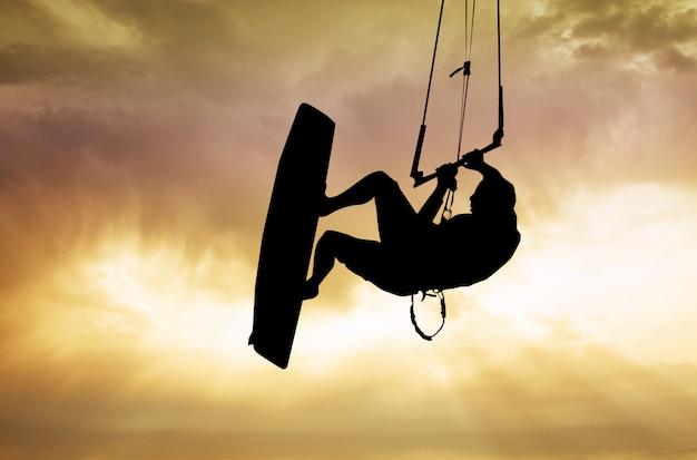 Illustration of kite surfer at sunset Premium Photo