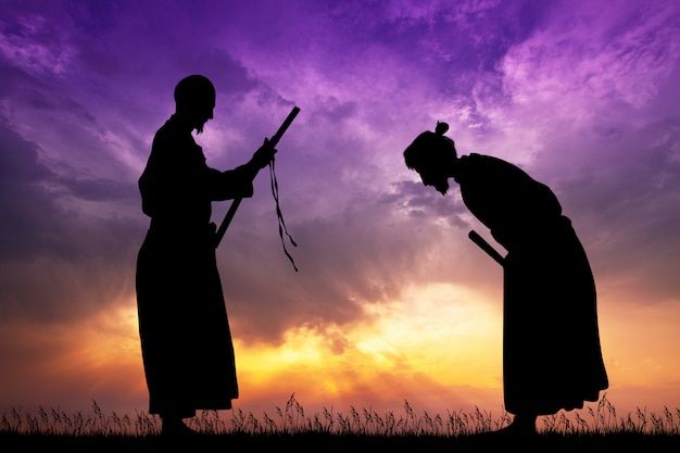 Illustration of samurai with katana at sunset Premium Photo