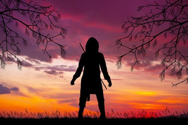 Illustration of silhouette of ninja man at sunset Premium Photo