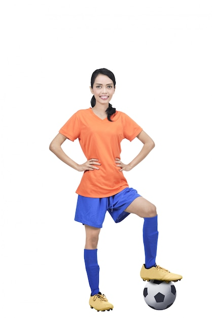 Image of asian football player with ball and hands on waist Premium Photo