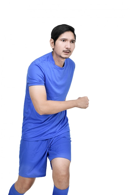 Image of asian footballer man ready for action Premium Photo