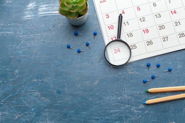 Image of business and meetings. calendar to remind you an important appointment and magnifying glass Premium Photo