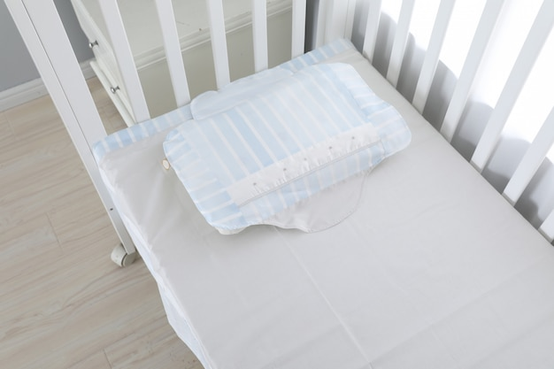 The image of child's bed under the white Premium Photo