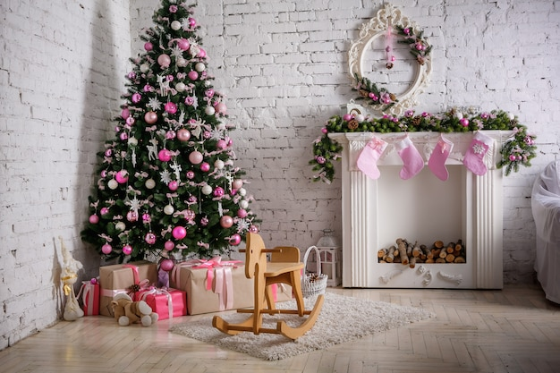 Image of chimney and decorated xmas tree with gift Premium Photo